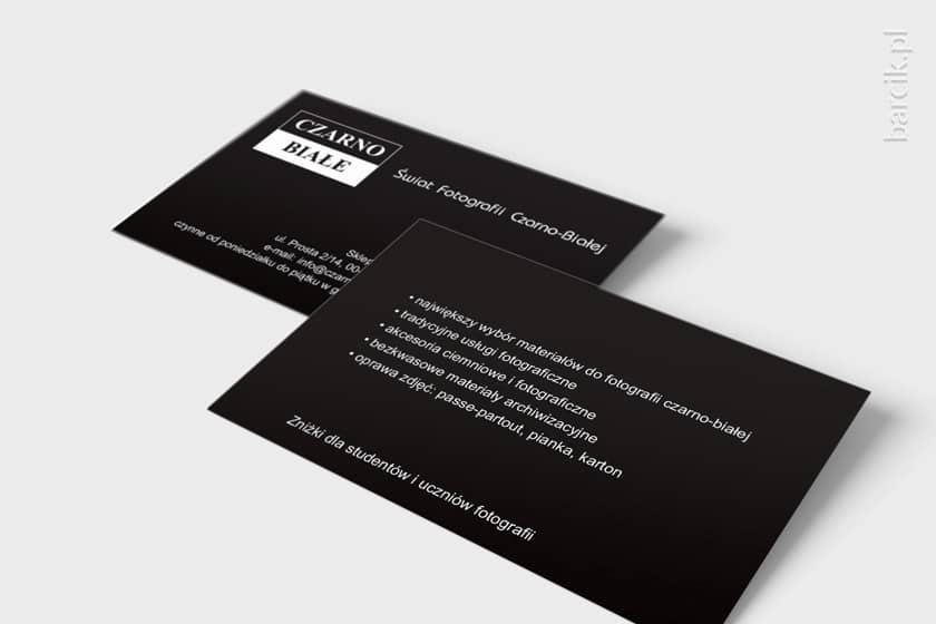 Wizytówki czarno białe z asortymentem sklepu na rewersie